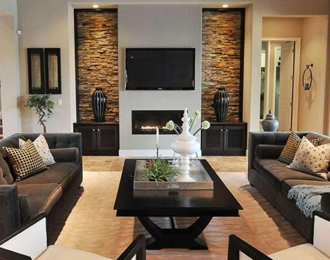 Декоративный камень в гостиной: преимущества и правила декорирования